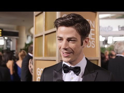 The Flash's Grant Gustin Talks That Rumored Supergirl Crossover at the Golden Globes